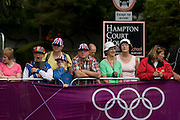 Local spectators beneath road access sign await the passing of the peloton on the first day of competition of the London 2012 Olympic 250km mens' road race. Starting from central London and passing the capital's famous landmarks before heading out into rural England to the gruelling Box Hill in the county of Surrey. Local southwest Londoners lined the route hoping for British favourite Mark Cavendish to win Team GB first medal but were eventually disappointed when Kazakhstan's Alexandre Vinokourov eventually won gold.