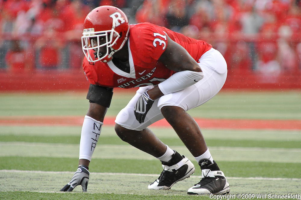 Sep 12, 2009; Piscataway, NJ, USA;  Rutgers defensive end George Johnson (31) sets up during the first half of Rutgers' 45-7 victory over Howard in NCAA College Football at Rutgers Stadium.