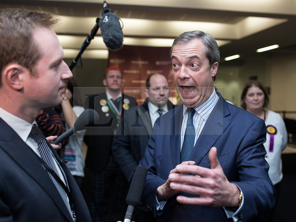 © Licensed to London News Pictures . 14/02/2014 . Manchester , UK . UKIP 's NIGEL FARAGE is interviewed after learning that UKIP came second . The count for the Wythenshawe and Sale East by-election , at Manchester Central this evening . Photo credit : Joel Goodman/LNP