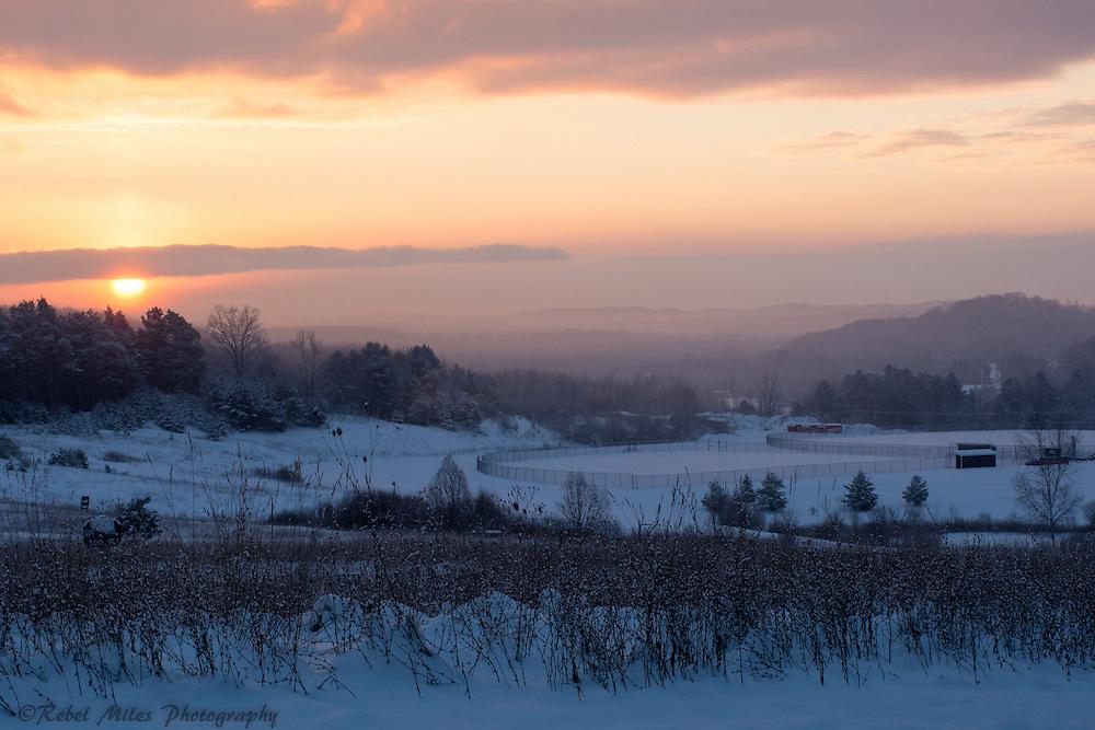 A December Morning Sun Breaks Through The Clouds