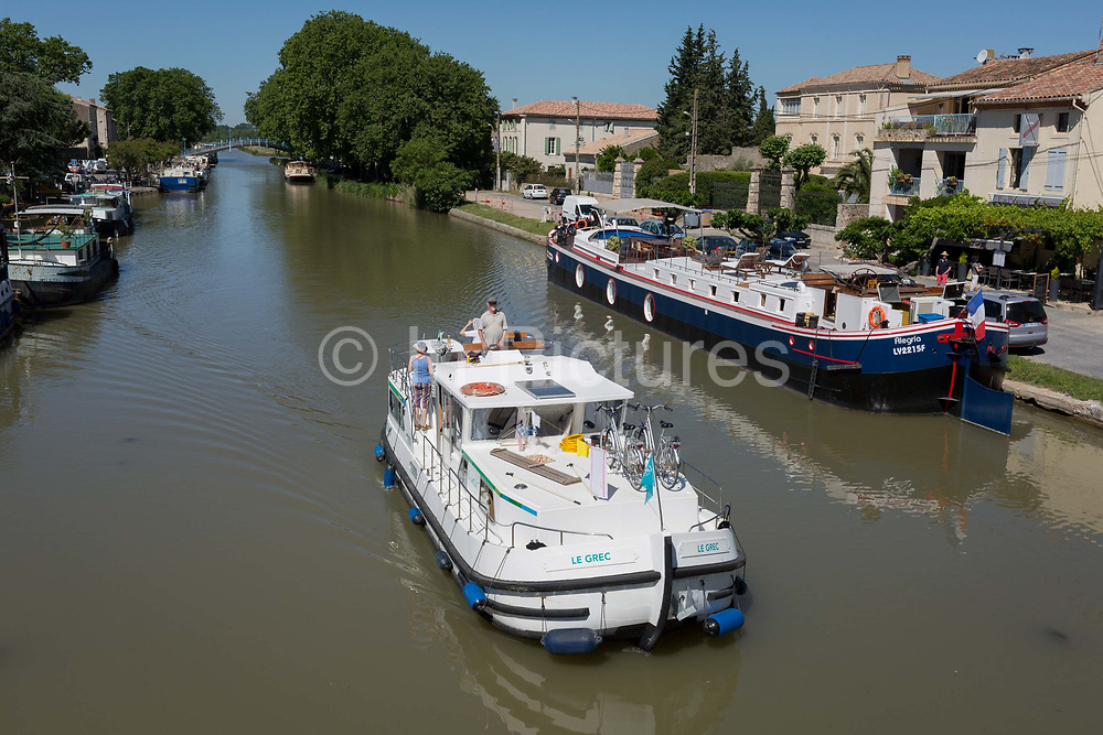 Aerial view of leisure boating including barges and cruisers on the Canal du Midi, on 25th May, 2017, in Homps, Languedoc-Rousillon, south of France.
