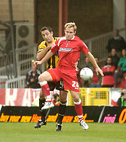 Photo: Leigh Quinnell.<br /> Swindon Town v Boston United. Coca Cola League 2. 30/09/2006. Swindons Royce Brownlie holds off Bostons Paul Ellender.