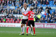 Cardiff city's Mats Daehli (l) with Fulham's Brede Hangeland. Barclays Premier league, Cardiff city v Fulham at the Cardiff city Stadium in Cardiff , South Wales on Sat 8th March 2014. pic by Andrew Orchard, Andrew Orchard sports photography