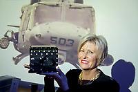 Liz Iversen, general manager/svp at Northrop Grumman Navigation Systems poses with an LN-251, an embedded navigation system.