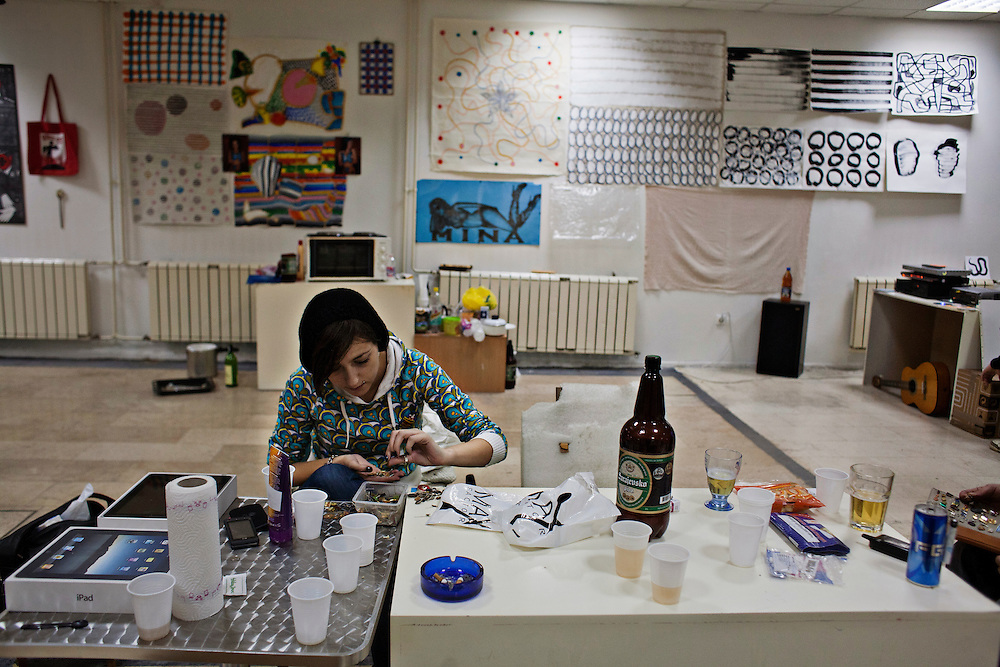 """Emina Huskic assembles pins from her collection of Yugoslavia-era pins for an unnamed project while hanging out in the """"Charlama Depot"""". The space is part gallery, factory, cafe and retrospective exhibition by Jusef Hadzifejzovic..."""