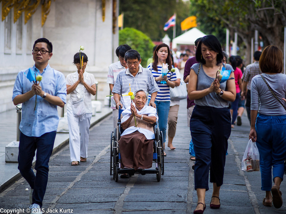 04 MARCH 2015 - BANGKOK, THAILAND: People participate in processions around the prayer hall at Wat Benchamabophit on Makha Bucha Day. Makha Bucha Day is an important Buddhist holy day and public holiday in Thailand, Cambodia, Laos, and Myanmar. Many people go to temples to perform merit-making activities on Makha Bucha Day. Wat Benchamabophit is one of the most popular Buddhist temples in Bangkok.    PHOTO BY JACK KURTZ