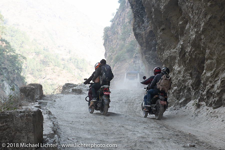 Locals riding through a narrow canyon on Day-7 of our Himalayan Heroes adventure riding from Tatopani to Pokhara, Nepal. Monday, November 12, 2018. Photography ©2018 Michael Lichter.Day-7 of our Himalayan Heroes adventure riding from Tatopani to Pokhara, Nepal. Monday, November 12, 2018. Photography ©2018 Michael Lichter.