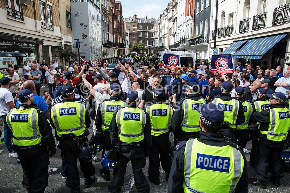 London, UK. 10th June, 2018. Members of far-right groups protest against the pro-Palestinian Al Quds Day march through central London organised by the Islamic Human Rights Commission. An international event, it began in Iran in 1979. Quds is the Arabic name for Jerusalem.