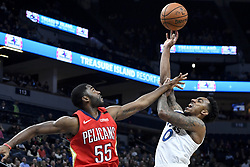 November 14, 2018 - Minneapolis, MN, USA - The New Orleans Pelicans' E'Twaun Moore (55) fouls the Minnesota Timberwolves' Jeff Teague (0) as Teague unsuccessfully attempts a shot in the second quarter on Wednesday, Nov. 14, 2018, at Target Center in Minneapolis. (Credit Image: © Aaron Lavinsky/Minneapolis Star Tribune/TNS via ZUMA Wire)