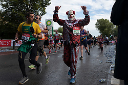 © Licensed to London News Pictures. 03/10/2021. London, UK. A runner in fancy dress gives a thumbs up as he passes through Greenwich as he takes part in the 2021 London Marathon.This London Marathon will be the first full scale staging of the race in more than two years due to the Coronavirus Pandemic.  Photo credit: George Cracknell Wright/LNP