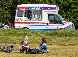 © Licensed to London News Pictures. 17/05/2020. London, UK. Members of the public relax in the sunshine on Wimbledon Common in South West London on the first weekend after the Government relaxed the law on lockdown to let people spend more time outside as weather experts predict 25c for the week ahead. Photo credit: Alex Lentati/LNP