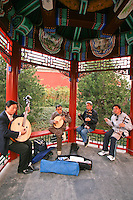 Chinese Street Musicians - Hutong life, as described by Beijingers, usually means local or courtyard life.  Yet the hutong, or alleys, are dear to the hearts of the citizens of this city.  Hutong life refers not only to the alleyways, but mostly to the neighborly way of life that is said to be disappearing.