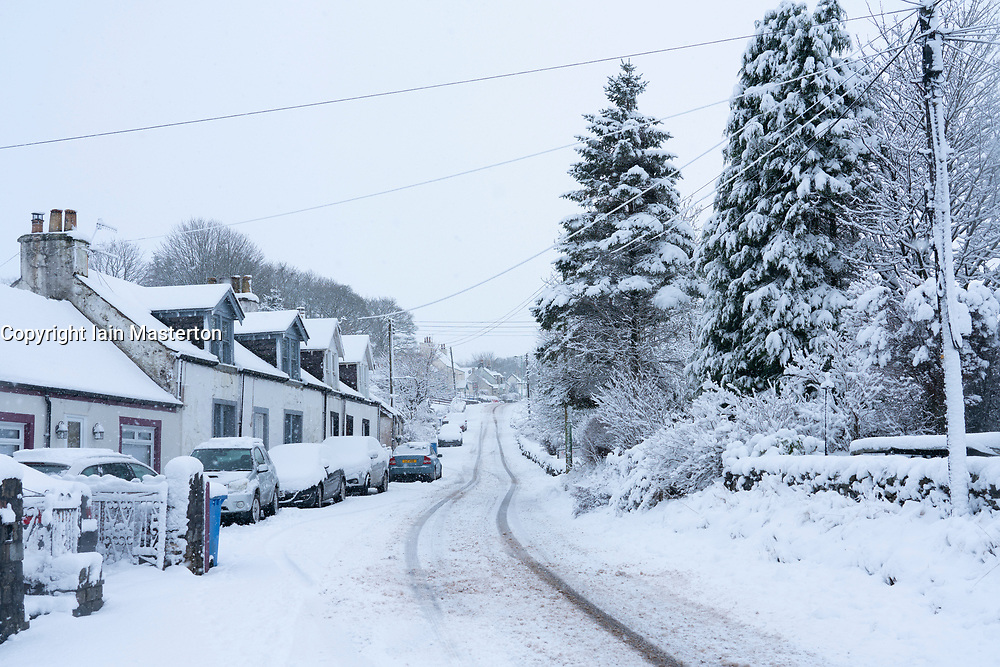 Leadhills, Scotland, UK. 27 December 2020. Heavy snow falls on Scotland's second highest village of Leadhills in South Lanarkshire.  Iain Masterton/Alamy Live News