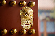 Nails and lion-head knocker on gate to Tower of Buddhist Incense at The Summer Palace, Beijing, China