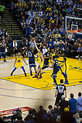 Golden State Warriors guard Klay Thompson (11) blocks a shot by Minnesota Timberwolves forward Andrew Wiggins (22) at Oracle Arena in Oakland, Calif., on January 25, 2018. (Stan Olszewski/Special to S.F. Examiner)