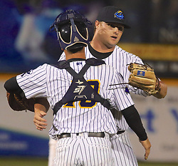 May 2, 2017 - Trenton, New Jersey, U.S - Closing pitcher CALE COSHOW embraces Trenton Thunder catcher JORGE SAEZ after the Thunder's 9-6 victory over the Harrisburg Senators at ARM & HAMMER Park. Saez homered twice in the game. (Credit Image: © Staton Rabin via ZUMA Wire)