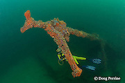 diver explores the wreck of the San Quentin or San Quintin, a Spanish gunboat sunk in 1898 during the Spanish-American War between Grande and Chiquita Islands near the entrance to Subic Bay, Philippines; wreckage is scattered over a reef at a depth of 9-18 m<br /> MR 379
