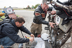 Victor Hugas of Texas helps Dean Bordigioni of California as he works on his Class-1 single-cylinder single-speed 1914 Harley-Davidson during the Motorcycle Cannonball Race of the Century. Stage-10 ride from Pueblo, CO to Durango, CO. USA. Tuesday September 20, 2016. Photography ©2016 Michael Lichter.