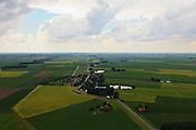Nederland, Overijssel, Gemeente Steenwijkerland, 30-06-2011; Blankenham, Kerkbuurt - met de vroegere Zuiderzee zeedijk. Links de regelmatige verkaveling van de Noordoost Polder, rechts de polders van het het oude land. De waterplassen bij de dijk zijn wielen of kolken, restanten van dijkdoorbraken..Environment Blankenham, boundary between the new land of the Noordoostpolder (left) and the old country. The dike is an old sea dike, the dike pools are remnants of earlier dyke  breaches..luchtfoto (toeslag), aerial photo (additional fee required).copyright foto/photo Siebe Swart
