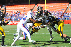 Nov 27, 2010; Kansas City, MO, USA; Missouri Tigers wide receiver T.J. Moe (28) leaps in for the touchdown as he's tackled by Kansas Jayhawks cornerback Daymond Patterson (15) in the first half of the game at Arrowhead Stadium. Mandatory Credit: Denny Medley-US PRESSWIRE