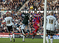 Photo: Kevin Poolman.<br />Derby County v Crystal Palace. Coca Cola Championship. 16/12/2006. Derby keeper Stephen Bywater tips the ball past the head of Mark Hudson of Palace.