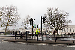 © Licensed to London News Pictures. 23/01/2019. London, UK.  An investigator at work in Forest Road, Walthamstow opposite the Town Hall where a 21 year old woman following a collision with a police car responding to a 999 call last night.  Photo credit: Vickie Flores/LNP