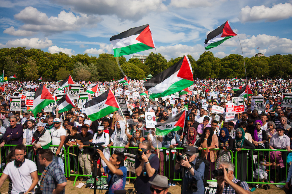 London, August 9th 2014. Part of the vast crowd, claimed by the organisers to have exceeded 150,000, who turned out in London in support of the people of Gaza.