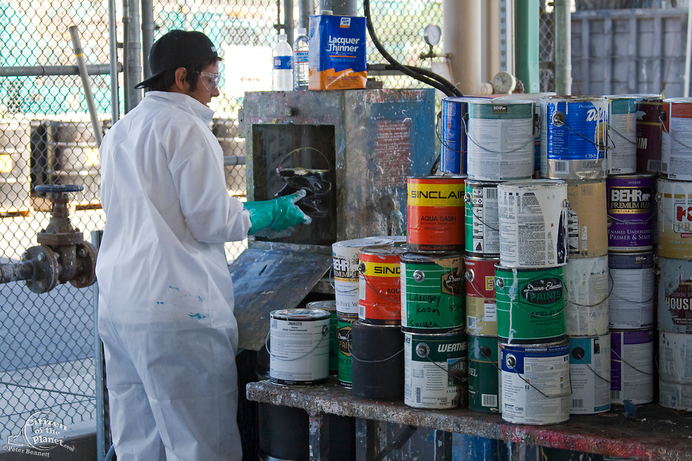 Workers crushes paint cans and squeezes out all residual paint. S.A.F.E  Collection Center, Sun Valley, Bureau of Sanitation for the City of Los Angeles, California, USA