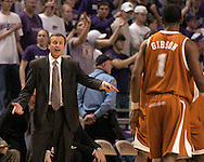 Texas head coach Rick Barnes (L) yells out to Daniel Gibson (R), during the second half against Kansas State at Bramlage Coliseum in Manhattan, Kansas, February 22, 2006.  The 7th ranked Longhorns held on for a 65-64 win over K-State.