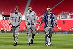 Tottenham Hotspur's (left-right) Ben Davies, Eric Dier and Christian Eriksen check out the pitch before the Premier League match at the bet365 Stadium, Stoke.
