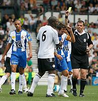 Photo: Steve Bond.<br />Derby County v RCD Espanyol. Pre Season Friendly. 04/08/2007.  Phil Dowd (R) books Raul Tamuda. Darren Moore (C) tries to diffuse the situation
