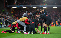 LIVERPOOL, ENGLAND - Wednesday, March 11, 2020: Club Atlético de Madrid's Marcos Llorente celebrates scoring his side's first goal in extra-time with team-mates during the UEFA Champions League Round of 16 2nd Leg match between Liverpool FC and Club Atlético de Madrid at Anfield. (Pic by David Rawcliffe/Propaganda)