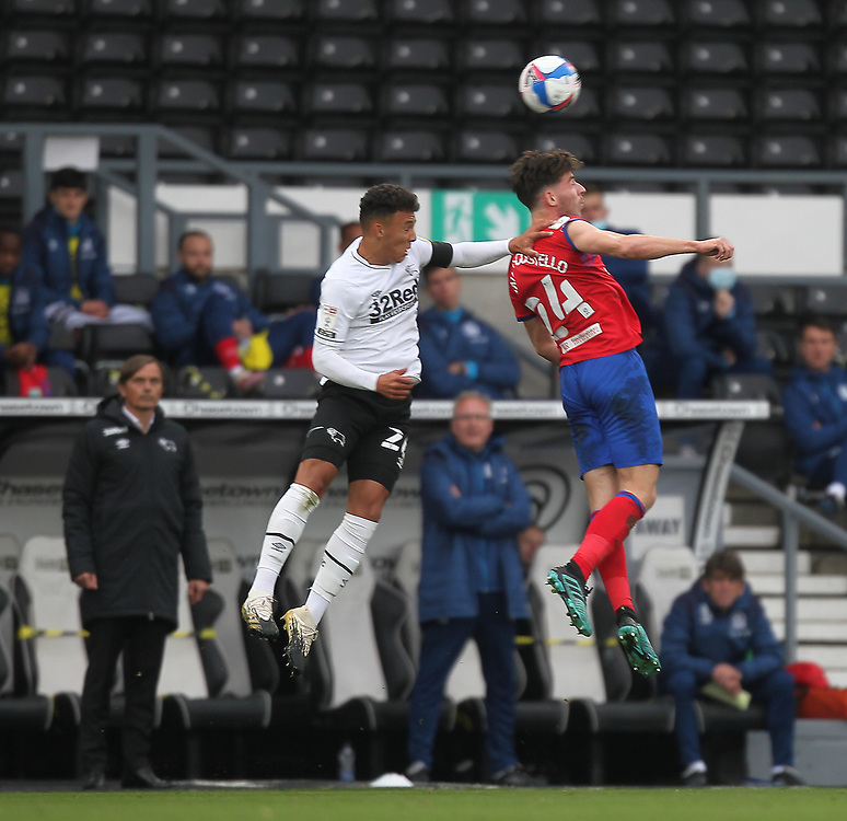 Blackburn Rovers' Joseph Rankin-Costello jumps with Derby County's Lee Buchanan<br /> <br /> Photographer Mick Walker/CameraSport<br /> <br /> The EFL Sky Bet Championship - Derby County v Blackburn Rovers - Saturday 26th September 2020 - Pride Park Stadium - Derby <br /> <br /> World Copyright © 2020 CameraSport. All rights reserved. 43 Linden Ave. Countesthorpe. Leicester. England. LE8 5PG - Tel: +44 (0) 116 277 4147 - admin@camerasport.com - www.camerasport.com