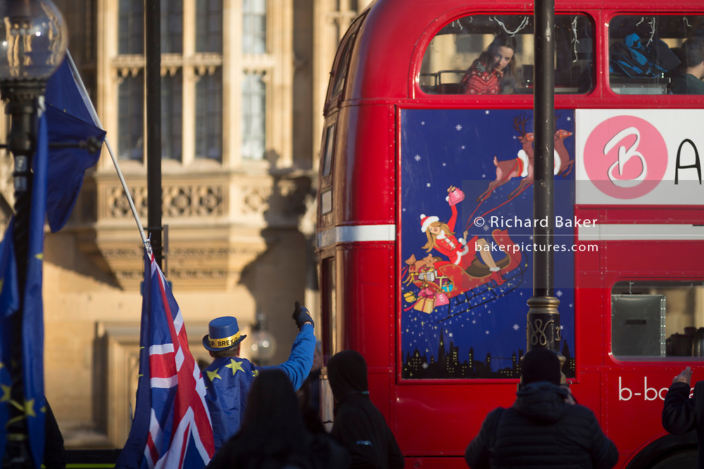 A pro-Europe, anti-Brexit protester gives a thumbs up to passing commuters outside the Houses of Parliament in Westminster, seat of government and power of the United Kingdom during Brexit negotiations with Brussels, on 1st December 2017, in Westminster, London, England.