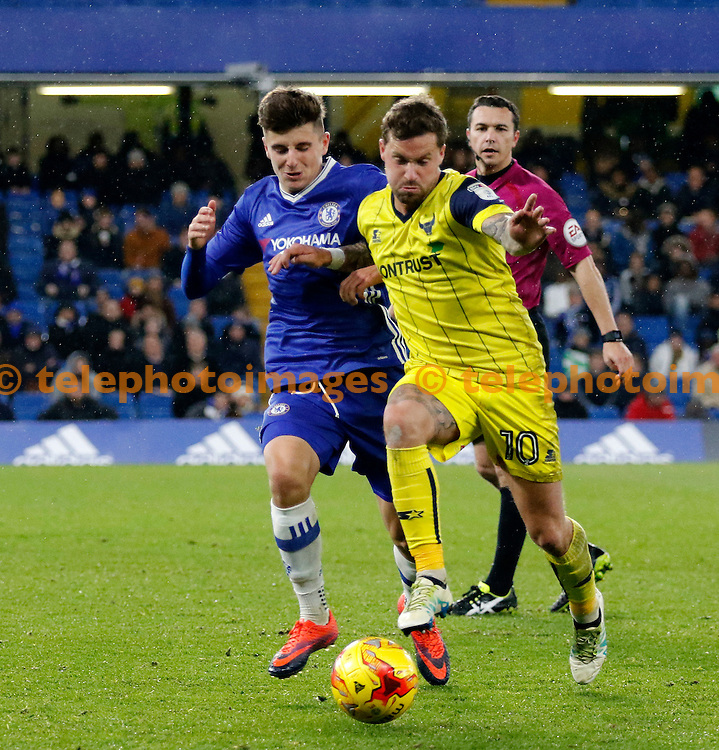 Oxford's Chris Maguire fends off Chelsea's Mason Mount during the Checkatrade Trophy match between Chelsea U21's and Oxford United at Stamford Bridge in London. November 8, 2016.<br /> Carlton Myrie / Telephoto Images<br /> +44 7967 642437