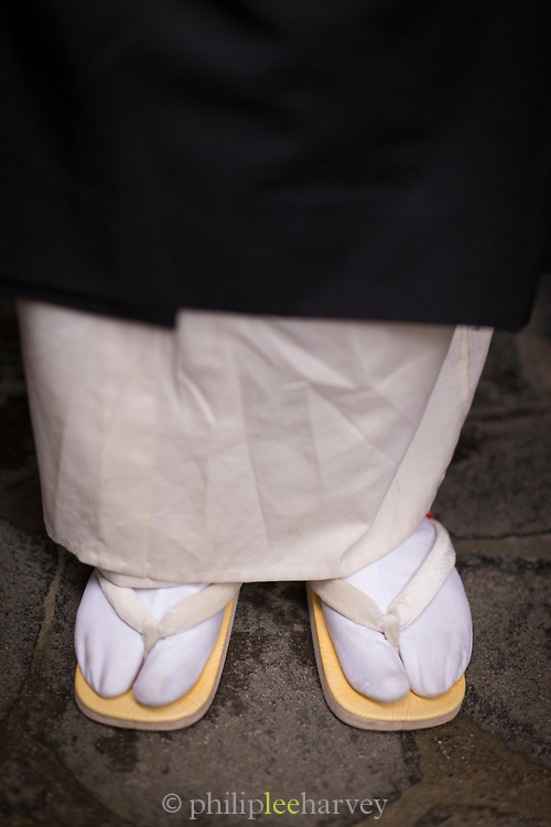 Close-up of man wearing sandals captured from high angle, Nagano, Japan