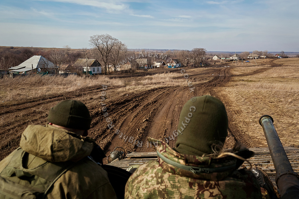 The Commander of the 54th Mechanised Brigade of the Ukrainian army (left) is riding a BMP (infantry fighting vehicle) in Myronivs'kyi, in order to reach his positions on the frontline with pro-Russia separatists.
