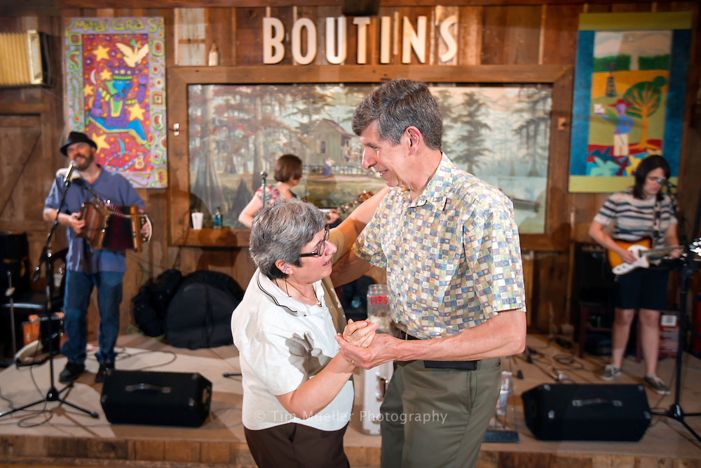 Mary Ann and John Krupsky dance as Lee Benoit and his Cajun band perform Saturday night' at Boutin's in Baton Rouge, La.