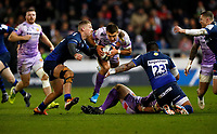 Rugby Union - 2019 / 2020 European Rugby Heineken Champions Cup - Pool Two: Sale Sharks vs. Exeter Chiefs<br /> <br /> Henry Slade of Exeter Chiefs is tackled by Denny Solomona and Robert Du Preez of Sale  at AJ Bell Stadium.<br /> <br /> COLORSPORT/LYNNE CAMERON