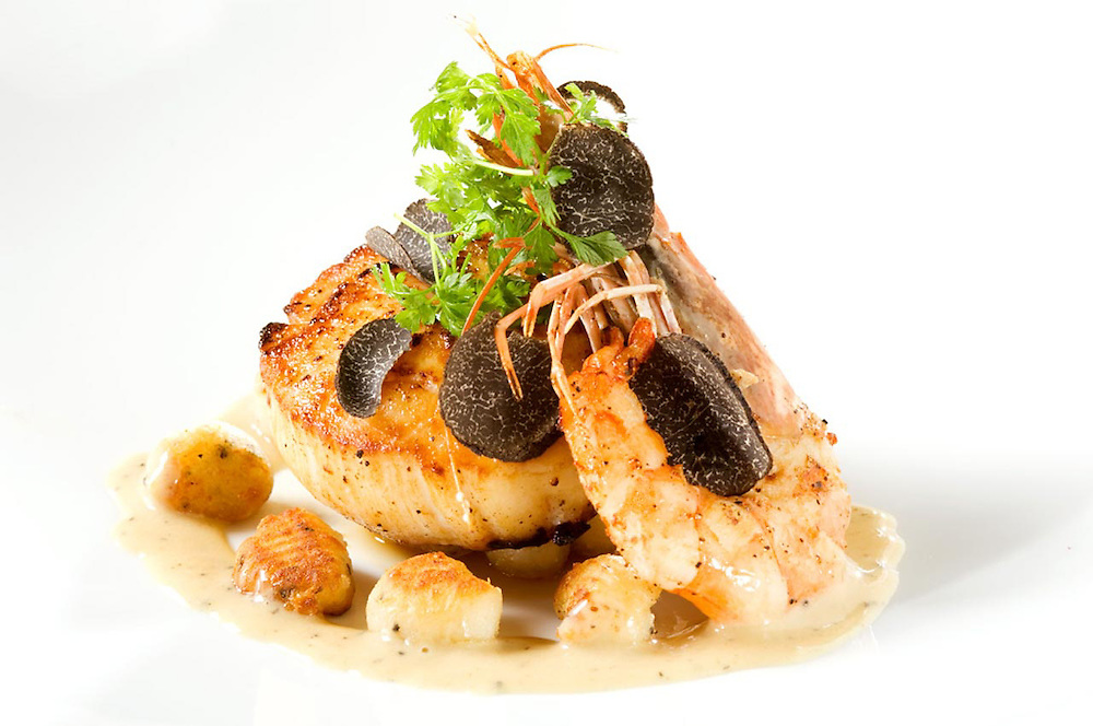 Giant sea scallop with bay scallops, large prawn and black truffles