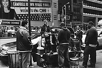Taking an interest in the Shoe Shine; 46th Street and 6th Ave.