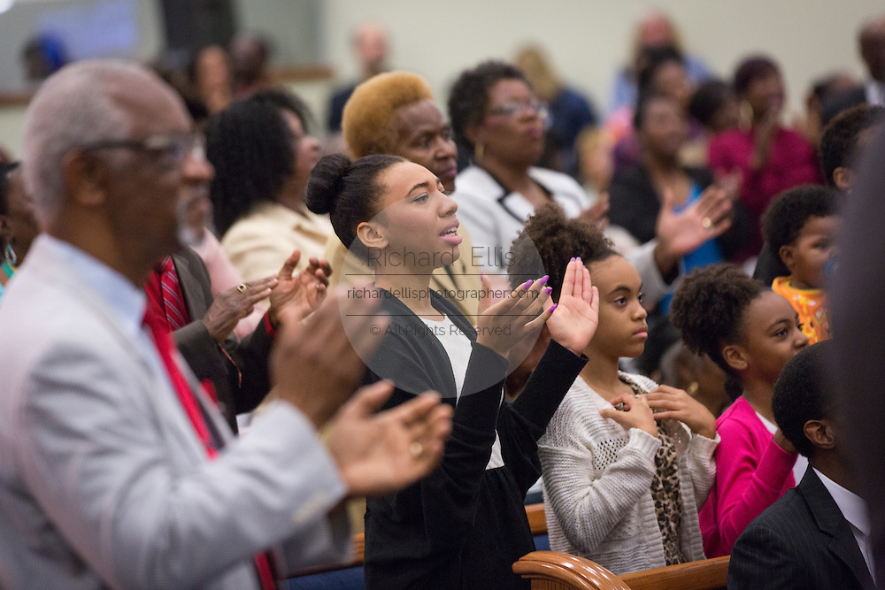 Worshippers react during a healing service at Charity Missionary Baptist Church April 12, 2015 in North Charleston, South Carolina. Sharpton spoke following the recent fatal shooting of unarmed motorist Walter Scott police and thanked the Mayor and Police Chief for doing the right thing in charging the officer with murder.