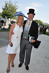 CHRIS WRIGHT and his wife JANICE at the Investec Derby at Epsom Racecourse, Epsom Downs, Surrey on 4th June 2011.