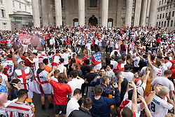 © Licensed to London News Pictures. 11/07/2021. London, UK. England supporters fill the road outside St Martin-in-the-fields near Trafalgar Square in central London on the day of the final of EURO 2020 at Wembley where England will play Italy. Photo credit: Peter Macdiarmid/LNP