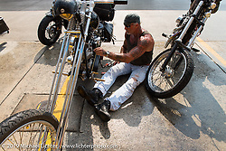 "The Horse Magazine publisher Ralph ""Hammer"" Janus fixing his Harley during a ride from Camp Lejeune Marine base in NC to Suck, Bang, Blow in Murrells Inlet in SC on the way to the Smokeout 2015. USA. June 17, 2015.  Photography ©2015 Michael Lichter."