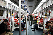 A  Chinese Liberation Army soldier takes a ride in a subway train in Shenzhen, China, on Thursday, Dec. 17, 2015.
