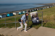 In an attempt to stop the littering of the borough's beaches, Canterbury City Council posters have appeared along the northern Kent coast of the Thames Estuary, where holidaymakers are returning to as the Coronavirus pandemic lockdown guidelines are gradually eased, and seasides become popular again after months of lockdown, on 19th July 2020, in Whitstable, Kent, England.