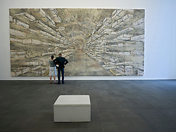 Looking at painting Sternenlager IV by Anselm Kiefer at Kuppersmuhle Museum at Innenhafen area of Duisburg in North Rhine-Westphalia Germany