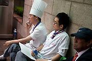 Koeche eines Restaurants entspannen sich bei einer Zigarette waehrend einer Pause in der Naehe des Express Bus Terminal im Zentrum der koreanischen Hauptstadt Seoul verladen.<br /> <br /> Cooks of a restaurant are relaxing with a cigarette during a break close to the Express Bus Terminal in the city center of the Korean capital Seoul.