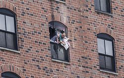 January 30, 2018 - Bloomington, MN, USA - A man leaned out a window where a suspect has been on a stand off with police for over a day on Tuesday, January 30, 2018, at the Graduate Hotel at the University of Minnesota in Minneapolis, Minn. ] RENEE JONES SCHNEIDER • renee.jones@startribune.com (Credit Image: © Renee Jones Schneider/Minneapolis Star Tribune via ZUMA Wire)